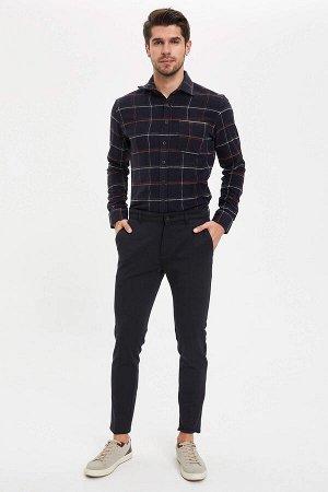 брюки Размеры модели: рост: 1,89 грудь: 100 талия: 74 бедра: 97 Надет размер: размер 32 - рост 32 Elastan 4%, Вискоз 15%, Полиэстер 81%