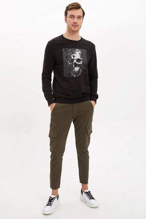 брюки Размеры модели: рост: 1,89 грудь: 99 талия: 75 бедра: 99 Надет размер: размер 30 - рост 30 Elastan 2%, Полиэстер 5%, Хлопок 93%