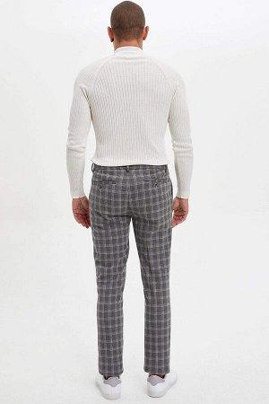 брюки Размеры модели: рост: 1,82 грудь: 98 талия: 81 бедра: 96 Надет размер: размер 32 - рост 32  Хлопок 19%, Полиэстер 78%,Elastan 3%