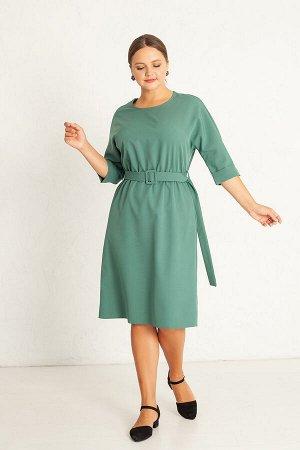 Платье Ткань: плательная, однотонная. Платье свободного покроя, с цельнокроенным рукавом, отрезное по талии, на резинке. К платью прилагается пояс с пряжкой в цвет основной ткани. Рукав ¾, отворотом.