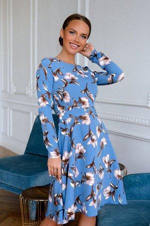 Платье Платье с расклешенной юбкой и цветами шикарно смотрится круглый сезон, придают настроение.Данный наряд уместен в любой ситуации, универсален. Синий приятный оттенок сочетается с текстурой тка