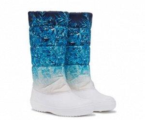 Сноубутсы Верх: водоотталкивающая ткань  Внешняя часть обуви изготовлена из водоотталкивающей ткани с оригинальными принтами, разработанными нашими дизайнерами. Для дополнительного удобства сзади расп