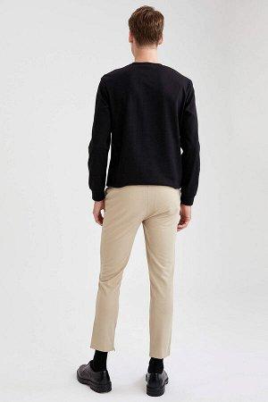 брюки Размеры модели: рост: 1,88 грудь: 98 талия: 82 бедра: 95 Надет размер: размер 32 - рост 30  Полиэстер 100%