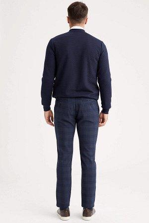 брюки Размеры модели: рост: 1,89 грудь: 98 талия: 80 бедра: 95 Надет размер: размер 32 - рост 32  Вискоз 33%, Полиэстер 64%,Elastan 3%