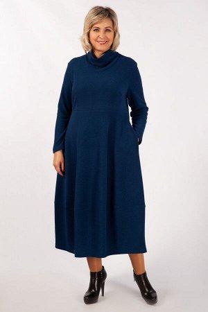 Платье Черный, хаки, синий, бордо.  Теплое, комфортное платье, выполнено из однотонного трикотажа. Отрезное по линии талии. Юбка расширена к низу в стиле «бохо». В боковых швах имеются потайные карман