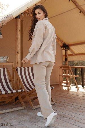 Бежевые свободные брюки из трикотажа