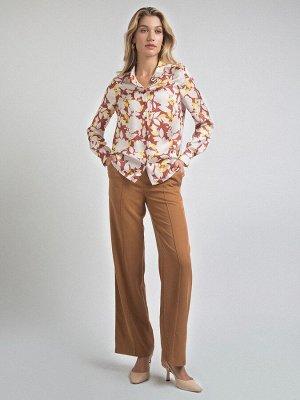 Блузка Состав ткани: 77% Полиэстер; 20% Вискоза; 3% Эластан Длина: 65 См. Описание модели Яркая блуза с флористическим принтом будет долго напоминать Вам о лете и станет ярким акцентом в осеннем гарде