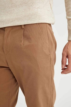 брюки Размеры модели: рост: 1,89 грудь: 100 талия: 81 бедра: 97 Надет размер: размер 32 - рост 32 Elastan 3%, Хлопок 97%