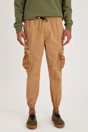 брюки Размеры модели: рост: 1,88 грудь: 90 талия: 79 бедра: 89 Надет размер: 32  Хлопок 98%,Elastan 2%