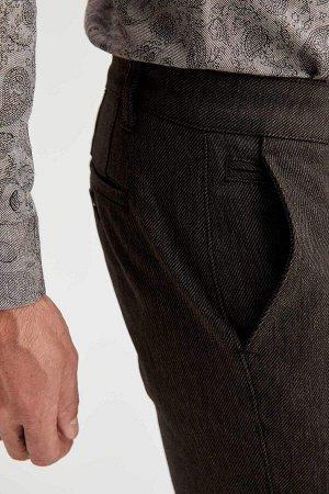 брюки Размеры модели: рост: 1,89 грудь: 100 талия: 81 бедра: 97 Надет размер: размер 32 - рост 32  Хлопок 67%,Elastan 1%, Полиэстер 32%