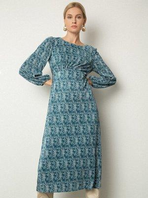 Платье Состав ткани: Полиэстер 80%, Вискоза 20% Длина: 115 См. Описание модели От синего платья с нежным цветочным принтом веет весенней свежестью. Модель А-силуэта и длины миди с отрезом под линией г