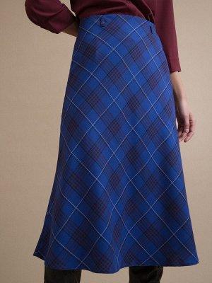 Юбка Состав ткани: Вискоза 100% Длина: 76 См. Описание модели Синяя юбка в клетку. Модель А-силуэта на подкладке, выполнена без пояса, линия талии акцентирована шлевками для ремешка. Подходит для созд