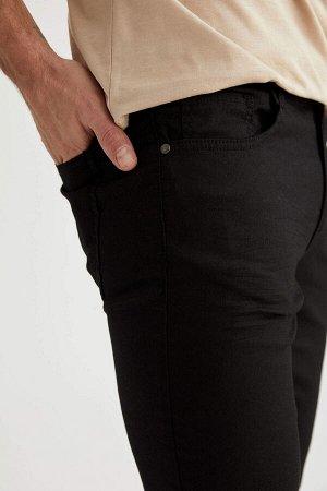 брюки Размеры модели: рост: 1,89 грудь: 100 талия: 81 бедра: 97 Надет размер: размер 32 - рост 32  Хлопок 66%,Elastan 3%, Полиэстер 31%