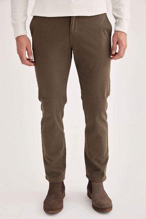брюки Размеры модели: рост: 1,88 грудь: 95 талия: 70 Надет размер: размер 30 - рост 32 Elastan 3%, Хлопок 97%