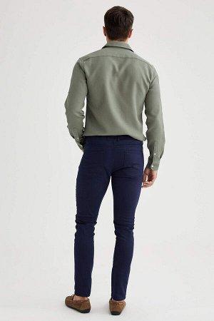 брюки Размеры модели: рост: 1,89 грудь: 100 талия: 81 бедра: 97 Надет размер: размер 32 - рост 32  Хлопок 68%,Elastan 4%, Полиэстер 28%