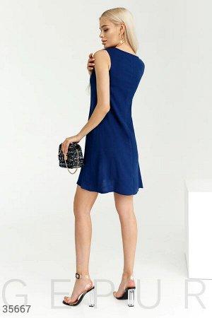 Синее платье а-силуэта с карманами