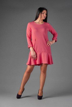 Платье Ткань: футер Сезон: Осень Цвет: Коралловый  Платье прилегающего силуэта. Рукава заканчиваются фигурным манжетом, по линии талии 3 шлевки (можно носить с поясом). Низ изделия разной длины с вола