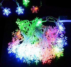 Гирлянда Гирлянда создаст уютную и сказочную атмосферу в вашем доме. Ею можно украсить окна, новогоднюю елку, зеркало и многое другое. Длина гирлянды - 5 метров. Источник света выполнен в виде снежино