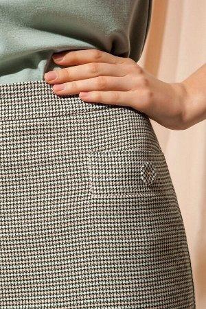 Юбка миди Рост: 170 см. Состав ткани: полиэстер 65%, вискоза 32%, эластан 3% Классическая юбка-карандаш из костюмной ткани с мелким дизайном «гусиная лапка» с содержанием вискозы зауженная к низу, дли