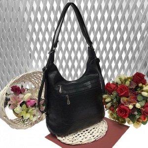 Функциональная сумка-рюкзак Verita из качественной матовой эко-кожи черного цвета.