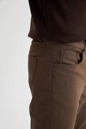 брюки Размеры модели: рост: 1,88 грудь: 98 талия: 82 бедра: 95 Надет размер: размер 32 - рост 32  Хлопок 67%,Elastan 4%, Полиэстер 29%
