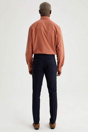 брюки Размеры модели: рост: 1,88 грудь: 95 талия: 70 Надет размер: размер 32 - рост 32  Вискоз 33%, Полиэстер 64%,Elastan 3%