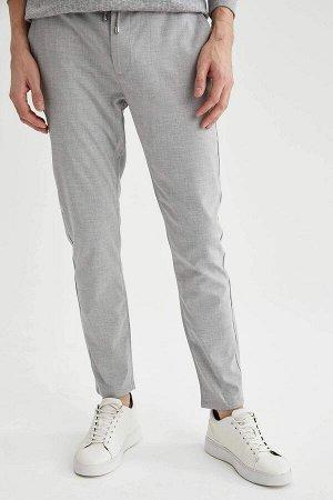 брюки Размеры модели: рост: 1,88 грудь: 98 талия: 82 бедра: 95 Надет размер: размер 32 - рост 32 Elastan 2%, Вискоз 33%, Полиэстер 65%