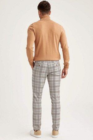 брюки Размеры модели: рост: 1,89 грудь: 100 талия: 74 бедра: 97 Надет размер: размер 32 - рост 30  Вискоз 34%, Полиэстер 64%,Elastan 2%