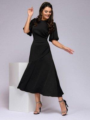 Платье черное длины миди с декоративной драпировкой