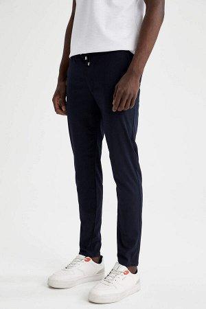 брюки Размеры модели: рост: 1,88 грудь: 95 талия: 70 Надет размер: размер 30 - рост 32 Elastan 2%, Вискоз 33%, Полиэстер 65%
