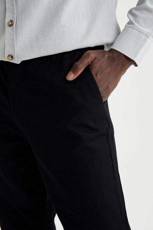 брюки Размеры модели: рост: 1,88 грудь: 95 талия: 70 Надет размер: размер 32 - рост 32  Хлопок 100%