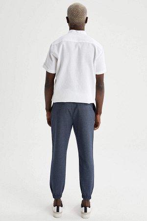 брюки Размеры модели: рост: 1,88 грудь: 95 талия: 70 Надет размер: размер 30 - рост 30 Elastan 2%, Вискоз 34%, Полиэстер 64%