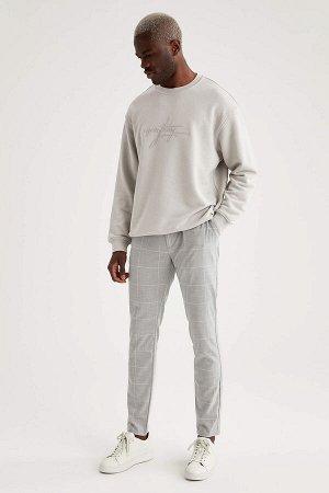 брюки Размеры модели: рост: 1,88 грудь: 95 талия: 70 Надет размер: размер 32 - рост 32 Elastan 4%, Вискоз 32%, Полиэстер 64%