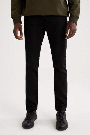 брюки Размеры модели: рост: 1,88 грудь: 95 талия: 70 Надет размер: размер 32 - рост 32  Хлопок 66%,Elastan 2%, Полиэстер 32%