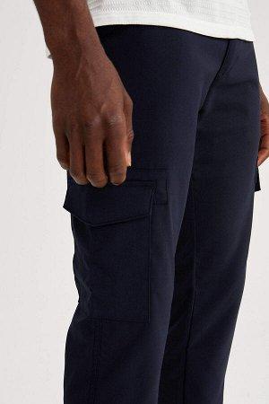 брюки Размеры модели: рост: 1,88 грудь: 95 талия: 70 Надет размер: размер 32 - рост 32 Elastan 2%, Вискоз 33%, Полиэстер 65%