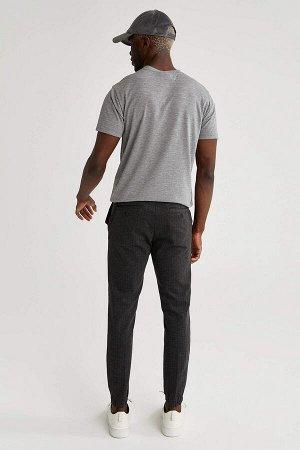 брюки Размеры модели: рост: 1,88 грудь: 95 талия: 70 Надет размер: размер 30 - рост 32 Elastan 4%, Вискоз 12%, Полиэстер 84%