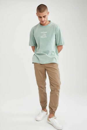 брюки Размеры модели: рост: 1,88 грудь: 92 талия: 70 бедра: 95 Надет размер: 32  Хлопок 98%,Elastan 2%