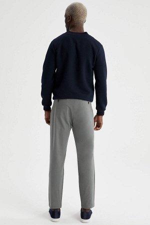 брюки Размеры модели: рост: 1,88 грудь: 95 талия: 70 Надет размер: размер 32 - рост 32  Хлопок 98%,Elastan 2%