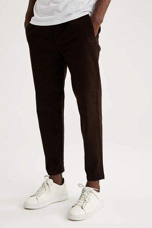 брюки Размеры модели: рост: 1,88 грудь: 95 талия: 70 Надет размер: размер 30 - рост 30 Elastan 2%, Хлопок 98%