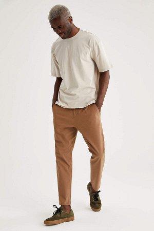 брюки Размеры модели: рост: 1,88 грудь: 95 талия: 70 Надет размер: размер 30 - рост 30  Хлопок 98%,Elastan 2%