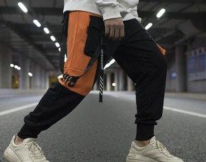 Брюки-джоггеры унисекс, нашивные карманы, декоративные ремешки с надписями, цвет черный/оранжевый