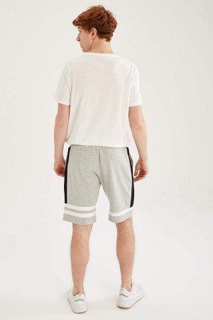 шорты Размеры модели: рост: 1,87 грудь: 93 талия: 80 бедра: 102 Надет размер: M  Хлопок 39%, Полиэстер 61%