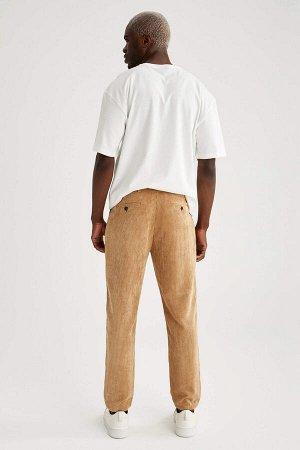 брюки Размеры модели: рост: 1,88 грудь: 95 талия: 70 Надет размер: размер 32 - рост 32  Полиэстер 100%