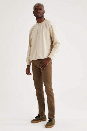 брюки Размеры модели: рост: 1,88 грудь: 95 талия: 70 Надет размер: размер 30 - рост 32 Elastan 2%, Полиэстер 32%, Хлопок 66%
