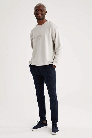 брюки Размеры модели: рост: 1,88 грудь: 95 талия: 70 Надет размер: размер 30 - рост 32 Elastan 1%, Хлопок 4%, Вискоз 19%, Полиэстер 76%
