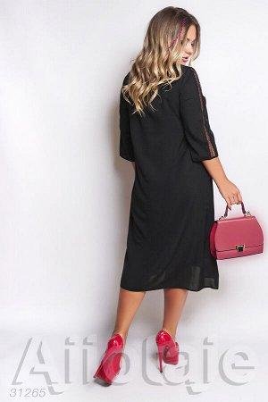 Черное шифоновое платье свободного силуэта