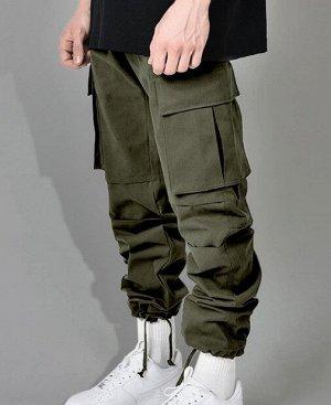 Мужские брюки, на резинке, утяжка по низу, дополнительные карманы по бокам, цвет темно-зеленый