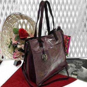 Роскошная сумка Diamond_Molecule из натуральной кожи с лазерной обработкой серебристо-сливового цвета.
