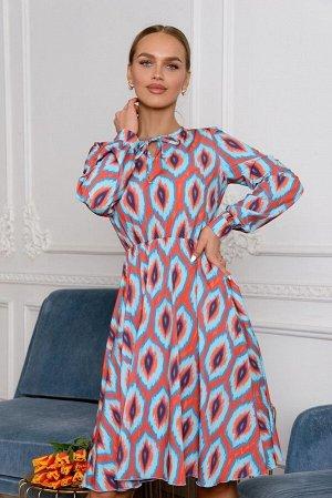 Платье Размер: 42 / 44 / 46 / 48 Уникальный узор напоминающий декоративное перо павлина никого не оставит равнодушным. Яркая, заметная, незабываемая модель платья 4654 сочетает в себе комфорт материал