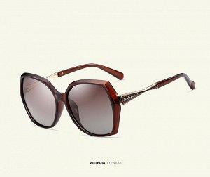 Женские солнцезащитные очки  в защитном чехле, коричневые линзы, коричневая оправа, дужки с интересным декоративным элементом в виде песочных цветов